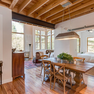 Example Of A Mountain Style Medium Tone Wood Floor And Brown Great Room Design In