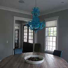 Industrial Dining Room by Fowler Custom Homes, Inc.