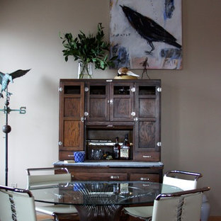 Example of a mid-sized eclectic dark wood floor kitchen/dining room combo design in Omaha with beige walls