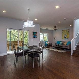 На фото: большие кухни-столовые в современном стиле с серыми стенами, темным паркетным полом и синим полом без камина