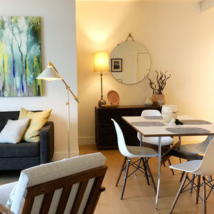 Example of a small mid-century modern laminate floor and beige floor kitchen/dining room combo design in Seattle with white walls