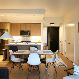 Inspiration for a small mid-century modern laminate floor and beige floor kitchen/dining room combo remodel in Seattle with white walls