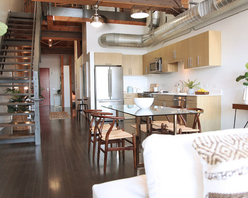 Example Of An Urban Brown Floor Great Room Design In Los Angeles With White  Walls