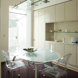 Inspiration for a contemporary carpeted and purple floor kitchen/dining room combo remodel in London with beige walls
