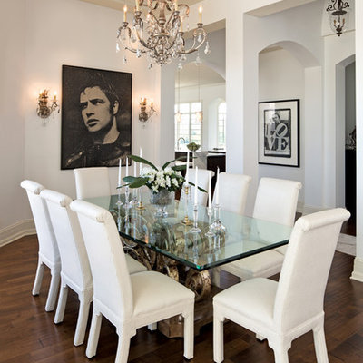 Example of a trendy dark wood floor dining room design in Indianapolis with white walls