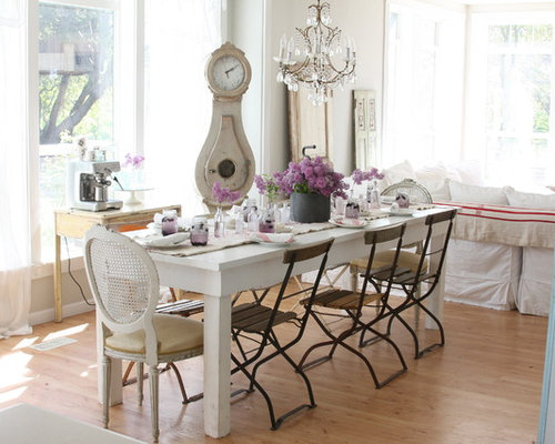 Shabby Chic Style Medium Tone Wood Floor Dining Room Idea In Other With  White Walls