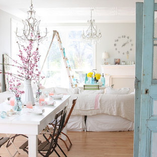 Dining room - shabby-chic style medium tone wood floor dining room idea in Other with gray walls