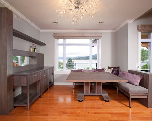 example of a minimalist dining room design in vancouver with gray walls