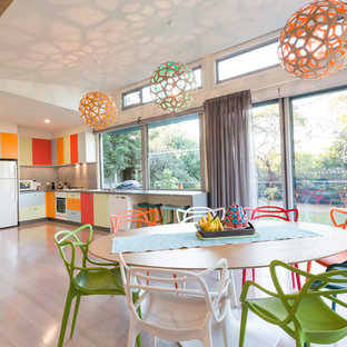 Photo of a large contemporary kitchen/dining combo in Melbourne.
