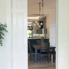 Eclectic Dining Room by tall glass architecture