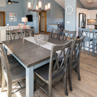 Medium sized beach style open plan dining room in Other with blue walls and vinyl flooring.