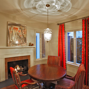 Inspiration for a small eclectic dark wood floor dining room remodel in Baltimore with a brick fireplace and a standard fireplace