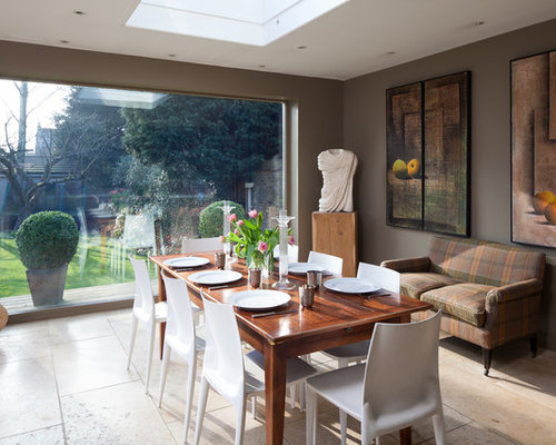 Inspiration For A Bohemian Dining Room In London With Brown Walls And Travertine Flooring