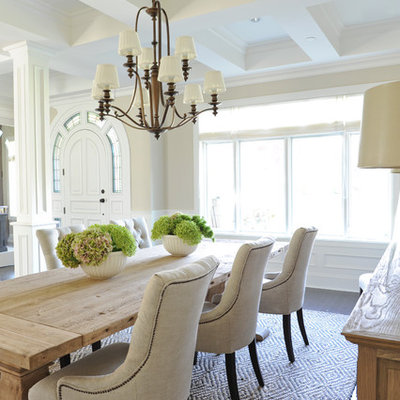 Example of a classic brown floor dining room design in Vancouver with beige walls