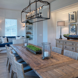 Design ideas for a nautical dining room in Other with white walls, medium hardwood flooring and brown floors.