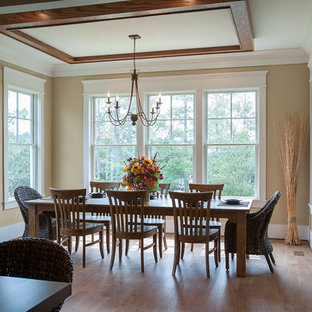 Photo of a classic dining room in Charleston with yellow walls.
