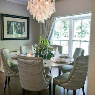 Contemporary enclosed dining room in Belfast with grey walls, dark hardwood flooring and brown floors.