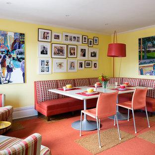 デンバーの小さいミッドセンチュリースタイルのおしゃれなダイニング (黄色い壁、赤い床) の写真