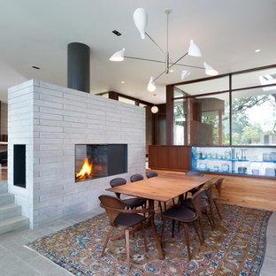 Inspiration för en mellanstor retro separat matplats, med en dubbelsidig öppen spis och en spiselkrans i trä