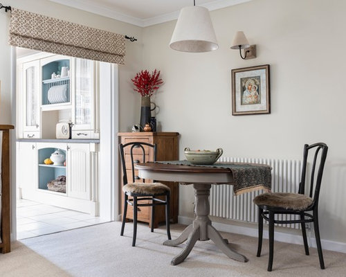 Photo Of A Traditional Open Plan Dining Room In London With Carpet And Beige Walls