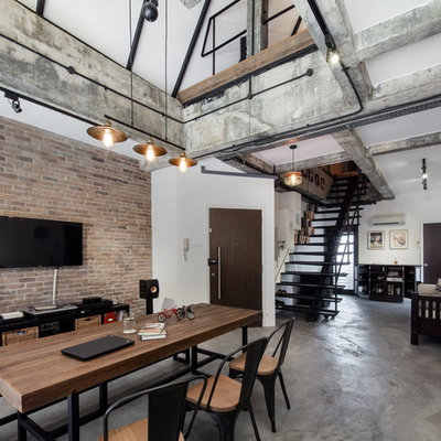 Inspiration for an industrial concrete floor great room remodel in Singapore with white walls and no fireplace