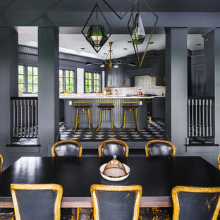 Example of a mid-sized eclectic carpeted kitchen/dining room combo design in New York with gray walls