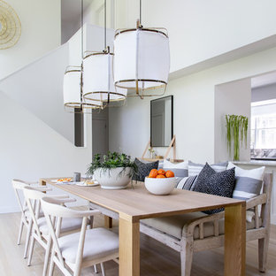 Great room - mid-sized transitional light wood floor and beige floor great room idea in New York with white walls