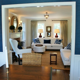 Great room - mid-sized coastal dark wood floor great room idea in New York with blue walls and a standard fireplace