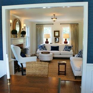 Foto de comedor costero, de tamaño medio, abierto, con paredes azules, suelo de madera oscura y chimenea tradicional