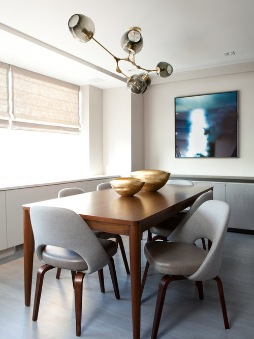 Inspiration For A Contemporary Painted Wood Floor And Gray Dining Room Remodel In New York