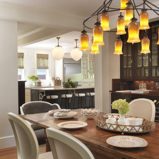 Inspiration for a timeless medium tone wood floor dining room remodel in Providence with white walls