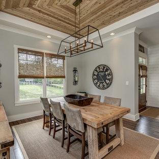 Cottage dark wood floor and brown floor dining room photo in Atlanta with gray walls