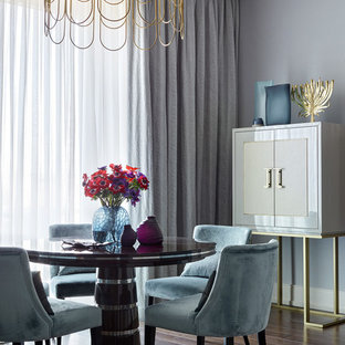 This is an example of a classic dining room in London with grey walls, dark hardwood flooring, no fireplace and brown floors.