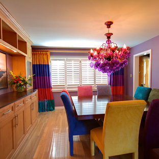 Design ideas for an eclectic dining room in Toronto with purple walls.