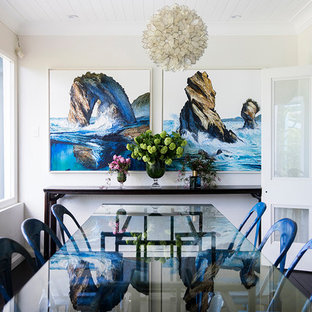 Photo of an eclectic separate dining room in Sydney with white walls, dark hardwood floors and black floor.
