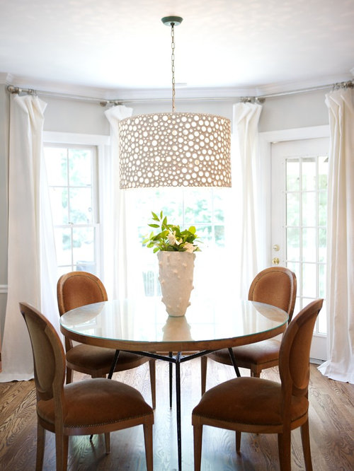 Example Of A Classic Dark Wood Floor Dining Room Design In Raleigh With  Gray Walls
