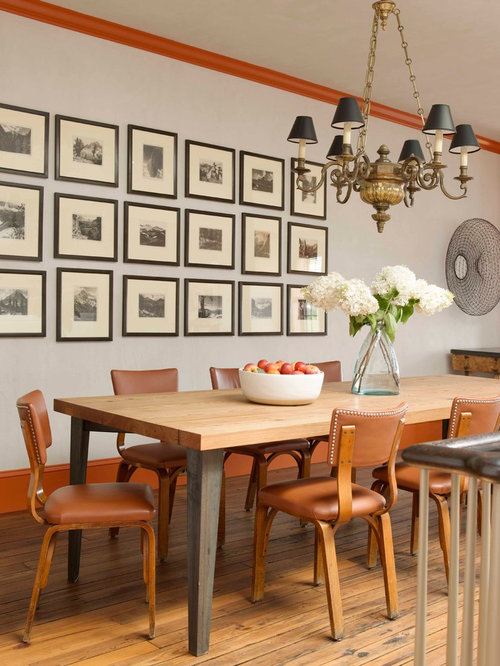 Beautiful Eclectic Medium Tone Wood Floor Dining Room Photo In New York With White  Walls Photo