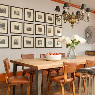 Eclectic medium tone wood floor dining room photo in New York with white walls