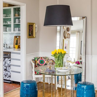 Eclectic medium tone wood floor dining room photo in DC Metro with gray walls
