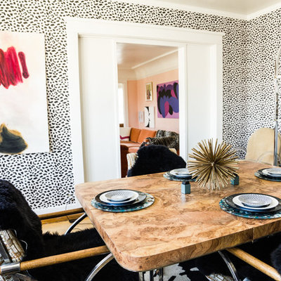 Eclectic medium tone wood floor dining room photo in Los Angeles with multicolored walls