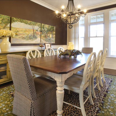 Example of an eclectic dark wood floor dining room design in Chicago with brown walls
