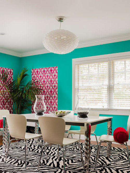 Example Of An Eclectic Dining Room Design In Boston With Blue Walls