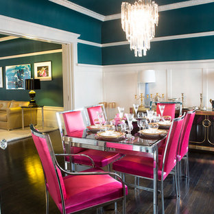 Inspiration for an eclectic separate dining room in Los Angeles with blue walls and dark hardwood floors.