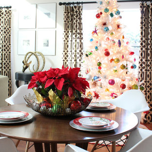 Example of an eclectic dining room design in Orange County