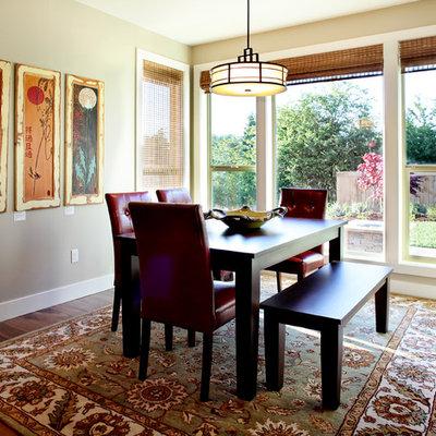Example of a trendy dark wood floor dining room design in Portland with beige walls