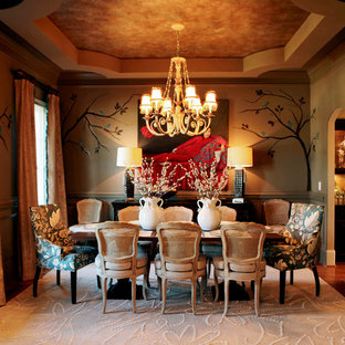 Inspiration for a traditional dining room in Charlotte with grey walls and dark hardwood flooring.