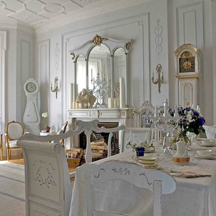 Photo of a shabby-chic style dining room in Other with a standard fireplace.