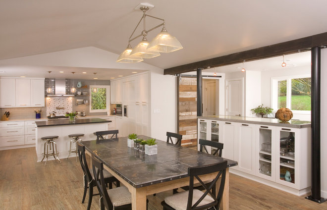 Contemporary Dining Room by REIER Construction