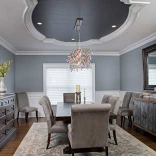 Example of a large classic dark wood floor enclosed dining room design in New York with blue walls