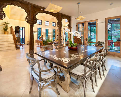 Example Of A Tuscan Great Room Design In Denver With Beige Walls